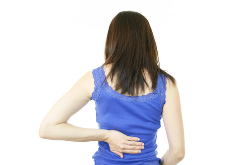 back pain female blue shirt